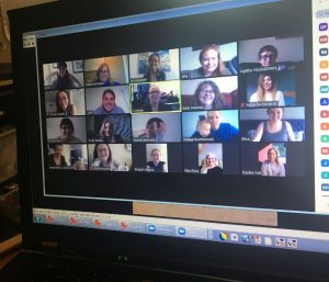 Photo of multiple staff in a virtual meeting