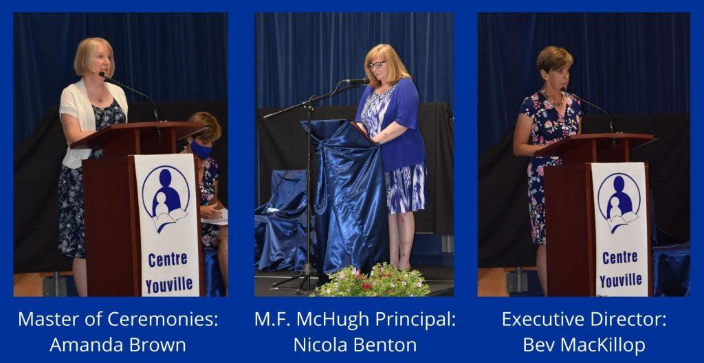 Photo of 3 speakers at podium for 2021 graduation