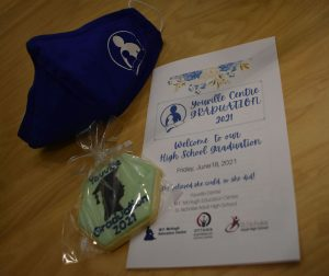Photo of Youville Centre Graduation 2021 program, cookie and mask